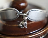 silver spoon bracelet with a dog charm by tangs and tines