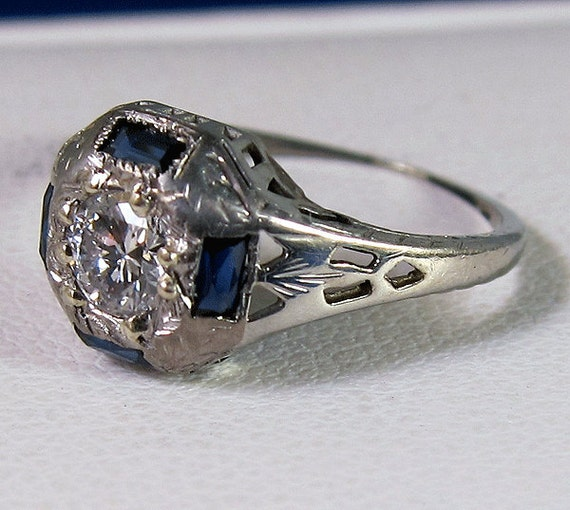 HOLDING - Amazing Antique 18k .32 carat  Diamond and Four Baguette Sapphire Ring