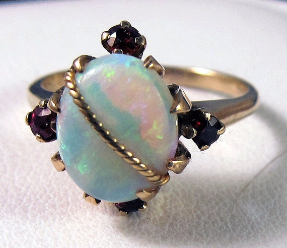 Vintage 10k Large colorful Opal with Gold Bar Decoration and Garnet Accents Ring