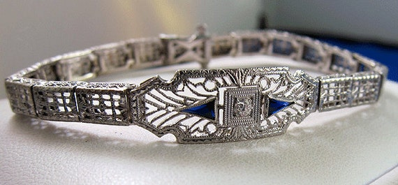 HOLDING --- Exquisite Antique Art Deco 14k Platinum Diamond Sapphire Bracelet