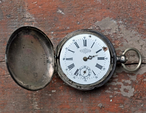 Antique Sterling Silver 0.875' pocket watch case with movement and circle..TOBIAS.
