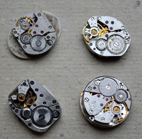 Lot of 4 vintage small watch movements with dial.