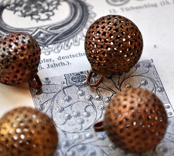 Set of 4 Vintage copper buttons.