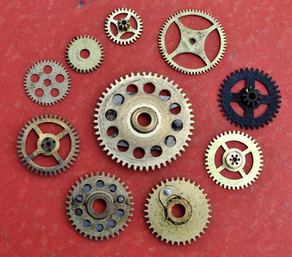 Lot of 10 Vintage brass alarm clock gears,wheels,cogs.(119)