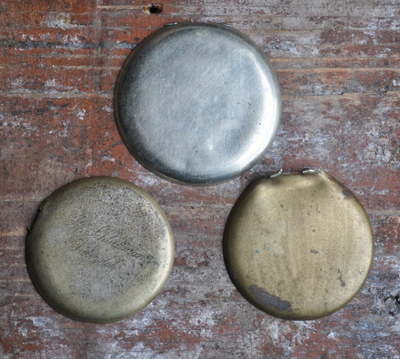 Set of 3 antique pocket watch back lids.