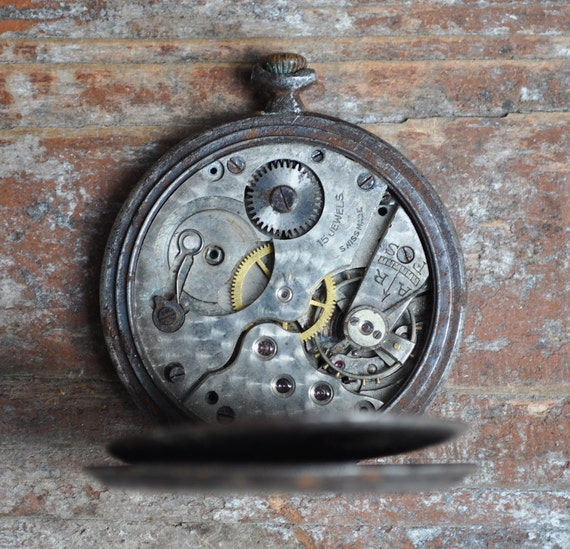 Antique pocket watch case with movement.