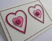 Red and pink hearts handstitched card with buttons