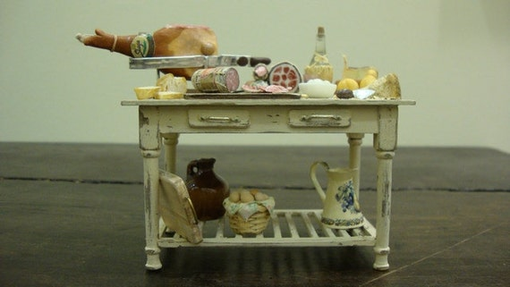 Miniature table  shabby chic set up with salami and typical Italian products