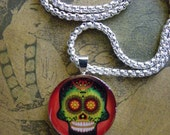 Sugar Skull in green w/red background Resin Pendant   (SP013)