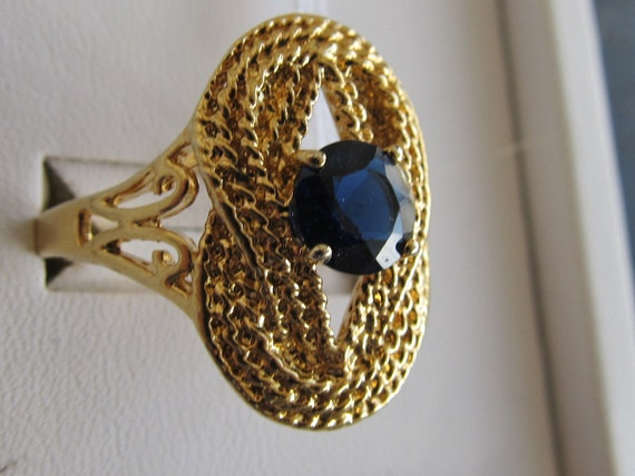 Large golden Nautical rope Knot framing Navy Sapphire rhinestone ring with Open Work accent sz 10