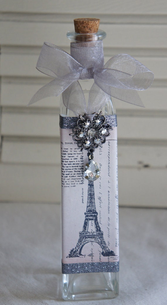 Decorative bottle with vintage french accents.