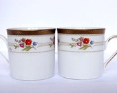 Two Winterling espresso cups with a gold and floral motif