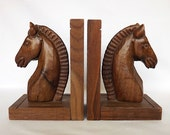 Two wooden horse bookends, hand carved