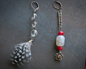 One of a kind red crystal, flower charm, and feather earrings