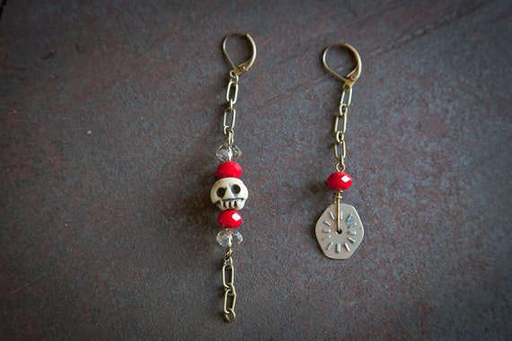 One of a kind steampunk earrings featuring vintage watch face, bone skull bead, and reclaimed chains