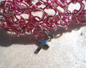 pink and silver knit wire bracelet with Cross