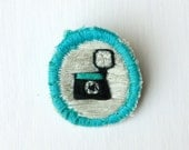 Merit Badge - Diana Camera