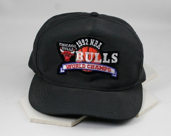 "Vintage Chicago Bulls 1992 ""World Champs"" Snapback Cap by Universal.  Free Vintage Bulls T-Shirt (1996 Champs).  Made in Dominican Republic."