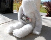 Bad fruit: Sculpture of a soft, white fluffy creature suffering from evisceration