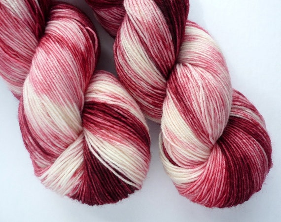 Hand Dyed 75/25 BFL/Nylon Fingering Weight Yarn in Strawberries and Cream Colorway