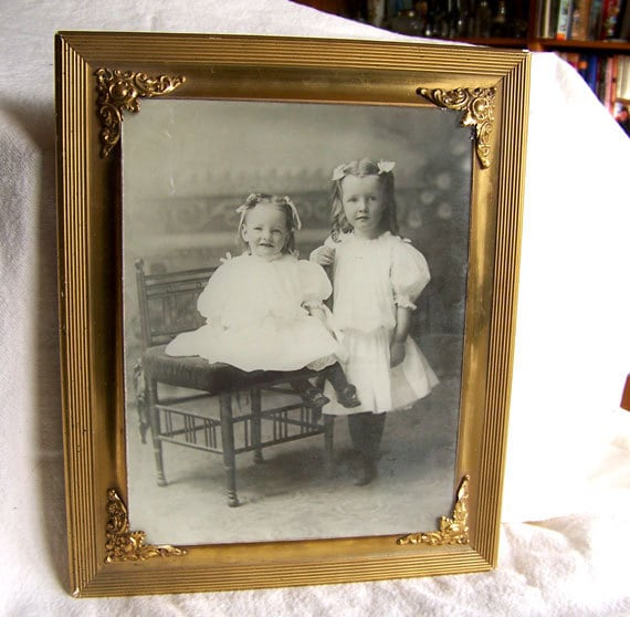 Victorian picture frame gilt with ormolu corners antique photograph of Victorian children about 10 x 12
