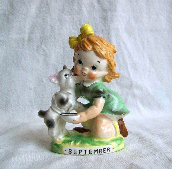 Ucagco figurine mid century September birthday month girl feeding cat Japan 1950s
