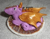 Purple and gold polymer clay Fimo bejewelled magic baby dragon in a sea shell malvern UK