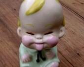 Spunky Baby Figurine With an Attitude