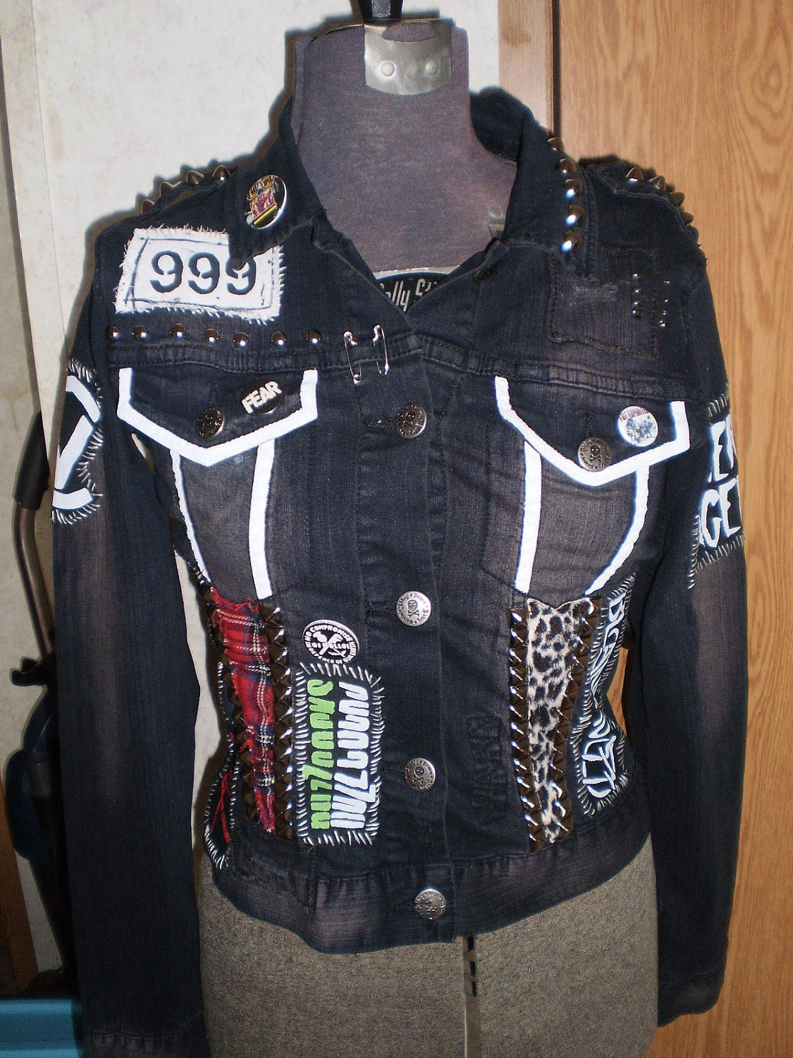 A denim jacket, distressed T-shirt and distressed, studded jeans became a visual representation for rock bands anti-establishment anthems. and distressed denim make Levi's Authentic Trucker Jacket the ultimate punk-rock piece. Pair it with a dark skinny or flowing frock—and start rocking.