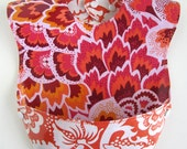 Baby-to-Toddler Bib, Waterproof & Wipeable, Snap Pocket, Reversible (Peacock Feathers / Blockprint Blossom Amber)