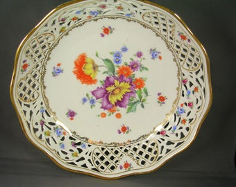 Schumann Porcelain Beautiful  9.5 inch reticulated porcelain center fruit bowl in the Schumann Chateau Dresden Flowers pattern. 1946 Era