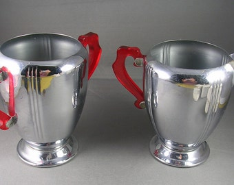 Art Deco Creamer and Sugar Chrome Stainless with Red Bakelite Handles 6 inches tall