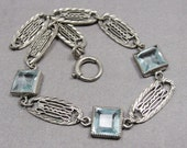 RESERVED...do not purchase 1920s Vintage Art Deco Bracelet Sterling Silver Filigree Aquamarine Blue Topaz Glass Crystals