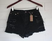 Vintage high waisted black Levi shorts