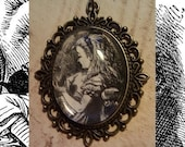 "Through the Looking Glass ""Alice With Worsted"" Pendant"