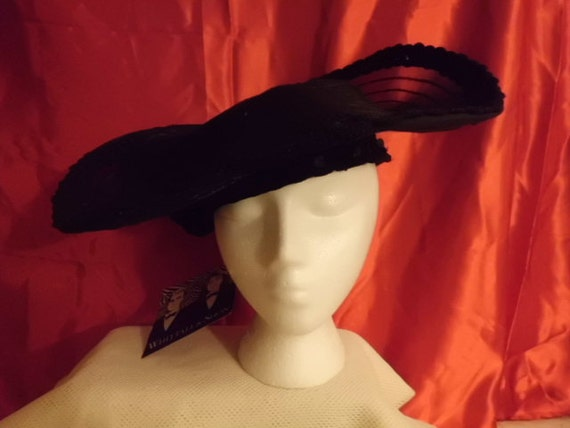 Fancy, Faboulus, High Fashion Womans Cocktail Hat with a mesh brim
