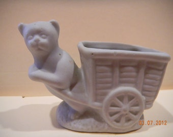 Vintage bisque cat figurine pulling cart..toothpick maybe..very old and cute miniature
