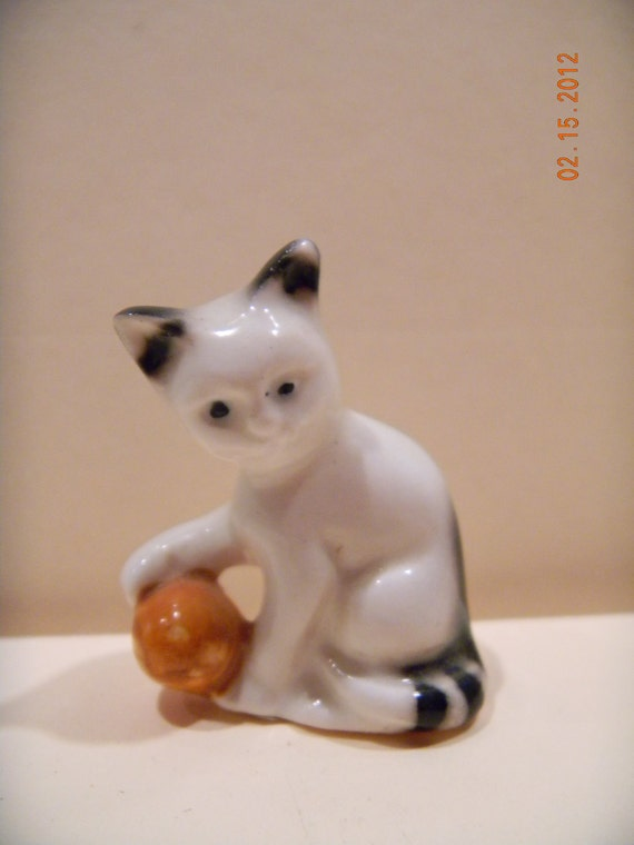 Miniature Goebel black and white kitten figurine with orange ball.. label..very small and cute..Germany