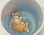Yellow Lying Tiger Cat Surprise Mug