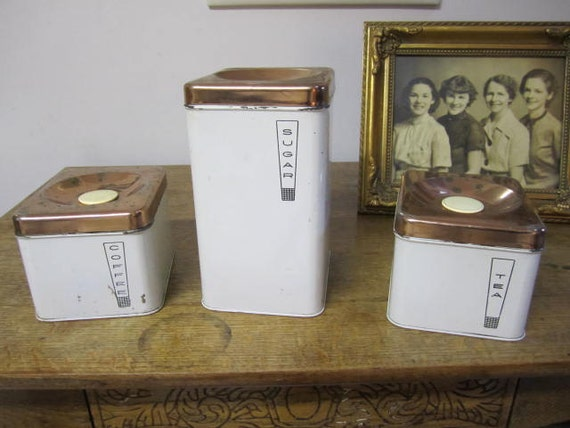 Set of Three Lincoln Beautyware cannisters.