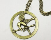 SALE - The Hunger Games pendant ,Inspired Mocking Jay Burning Golden Necklace