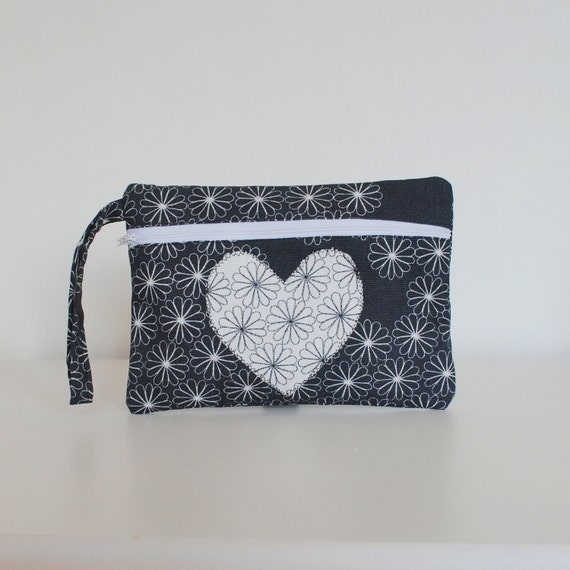 CLOSING DOWN SALE . Wristlet zippy purse. Grey and white daisy print, applique heart.