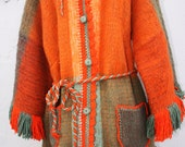 Unique vintage orange wool fringe hippie coat. Size medium or large 6-8-10