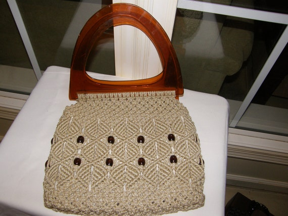 This Handbag is an Extraordinary Example of Vintage Macrame and Beads with Root Beer Colored Plastic Handles