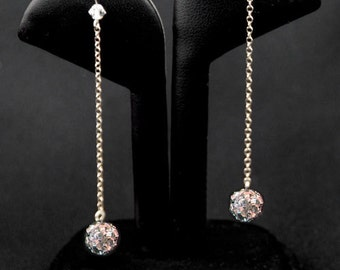 The Allison earrings are made from Swarovski crystal spheres and sterling silver chain.  A dramatic drop earring that is full of life.