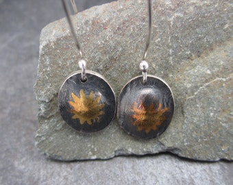 Starburst drop earrings made from sterling silver and gold