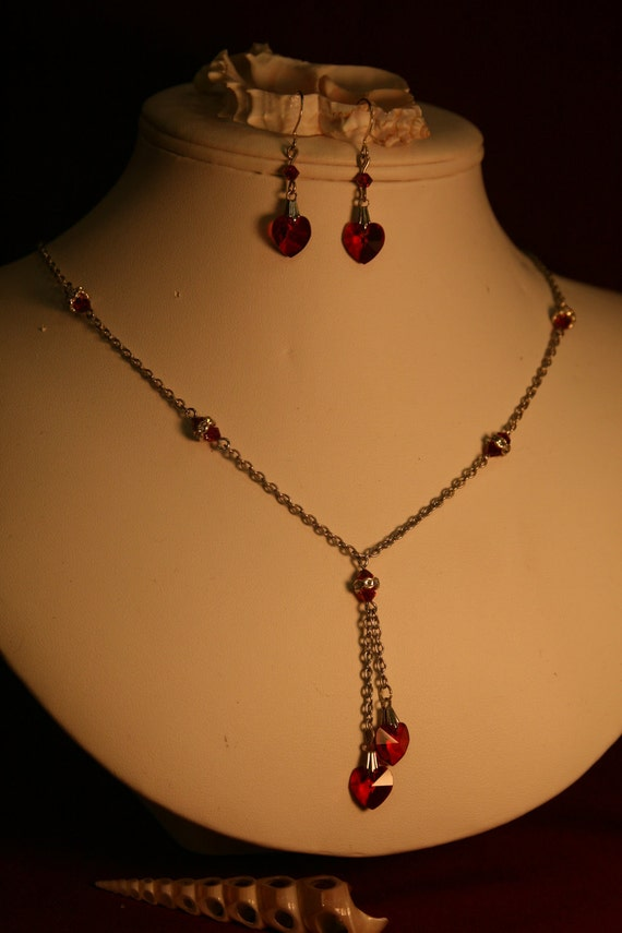 Swarovski red heart crystal necklace and earing set.