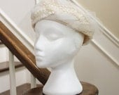 I do vintage white pillbox hat with tulle