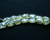 Zirconium, rectangular, micro faceted, pale green color