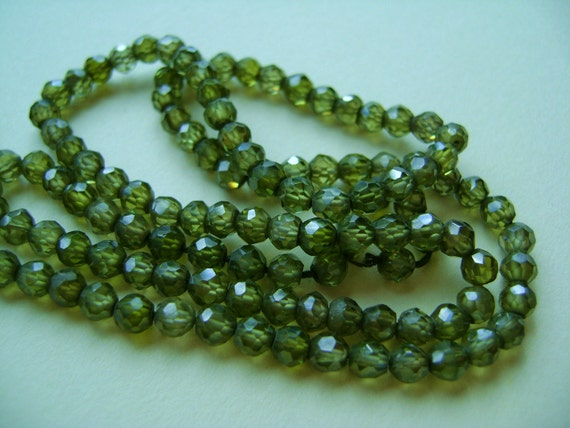 Olive Green Zircon, Faceted Rounds